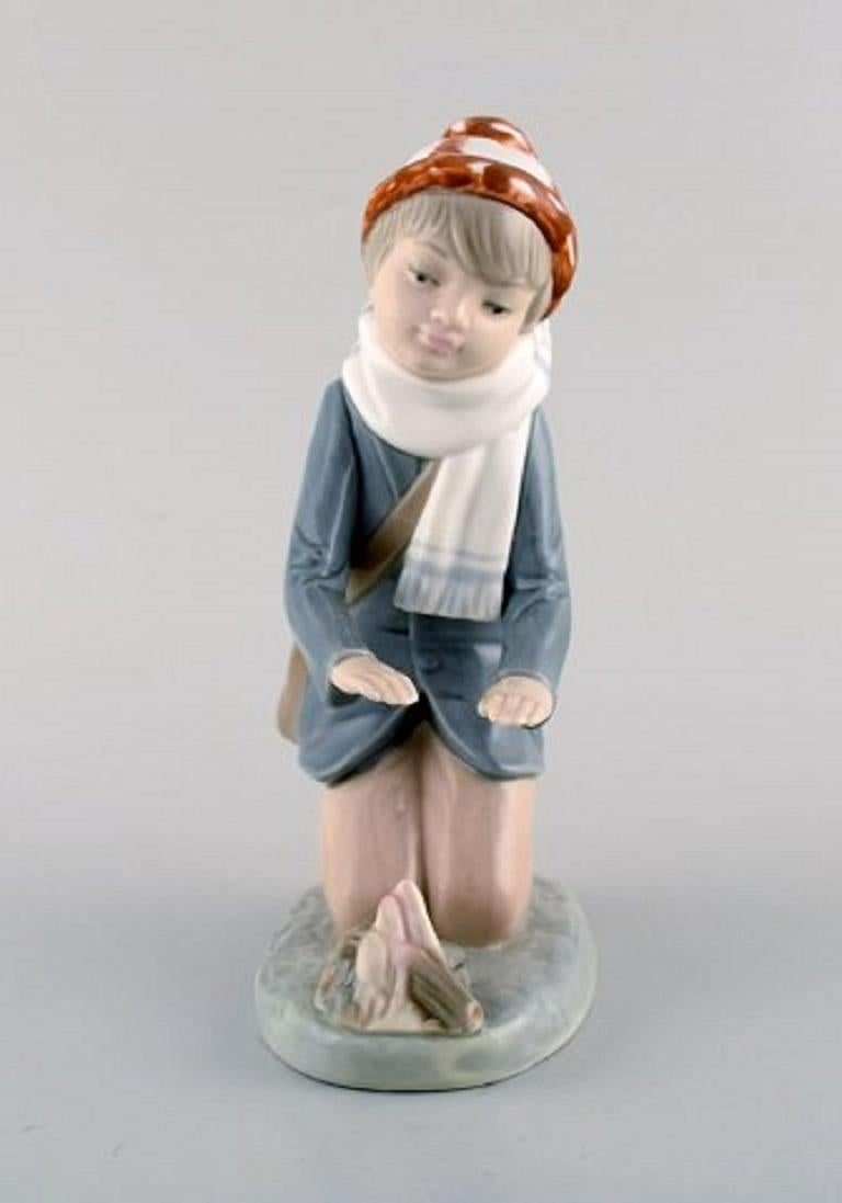 Lladro, Tengra and Zaphir, Spain. Four porcelain figurines of children, 1980s-1990s. Largest measures: 21 x 11 cm. In very good condition. Stamped.