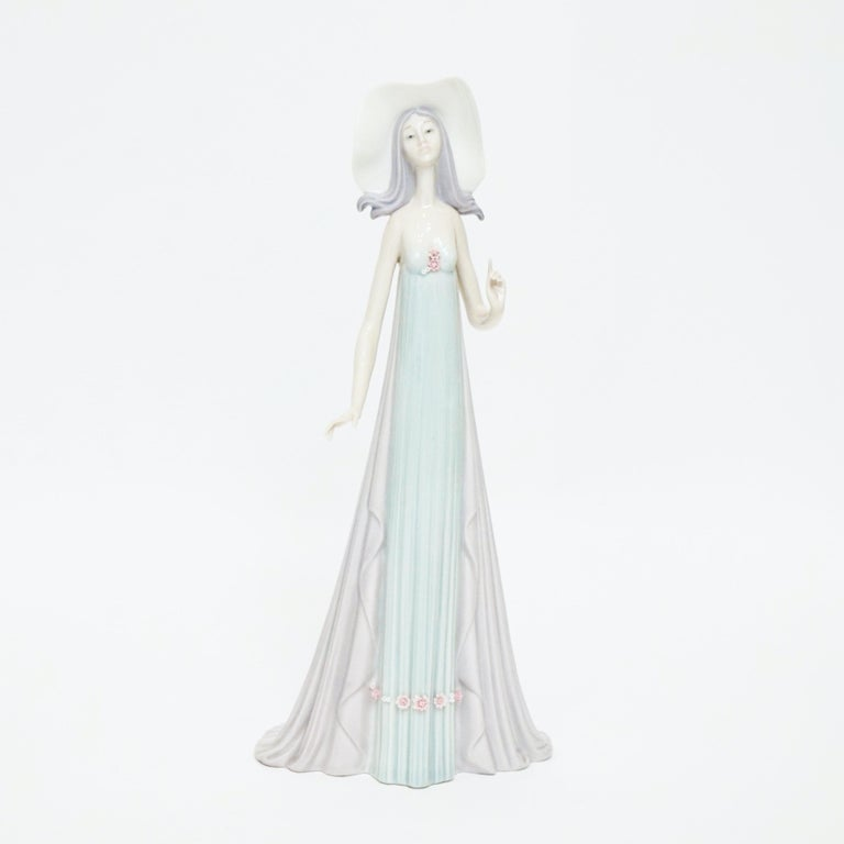 This beautiful and whimsical retired design by Lladro artist Jose Puche is called