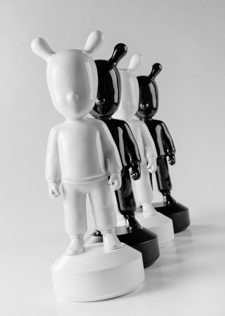 White glossy porcelain figurine created by Jaime Hayon for the collection The Guest by LLadró Atelier with a white base attached to the piece. The Guest is a piece created by Jaime Hayon for The Guest collection by Lladró Atelier, the brand's ideas