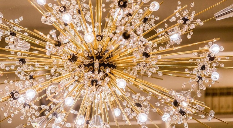 Designer: Hans Harald Rath, Lobmeyr  Year of Design: 1966   About the piece:   2016 marked the 50th anniversary of the Metropolitan chandelier creation, designed by Hans Harald Rath for the Metropolitan Opera in New York. The Lincoln Center