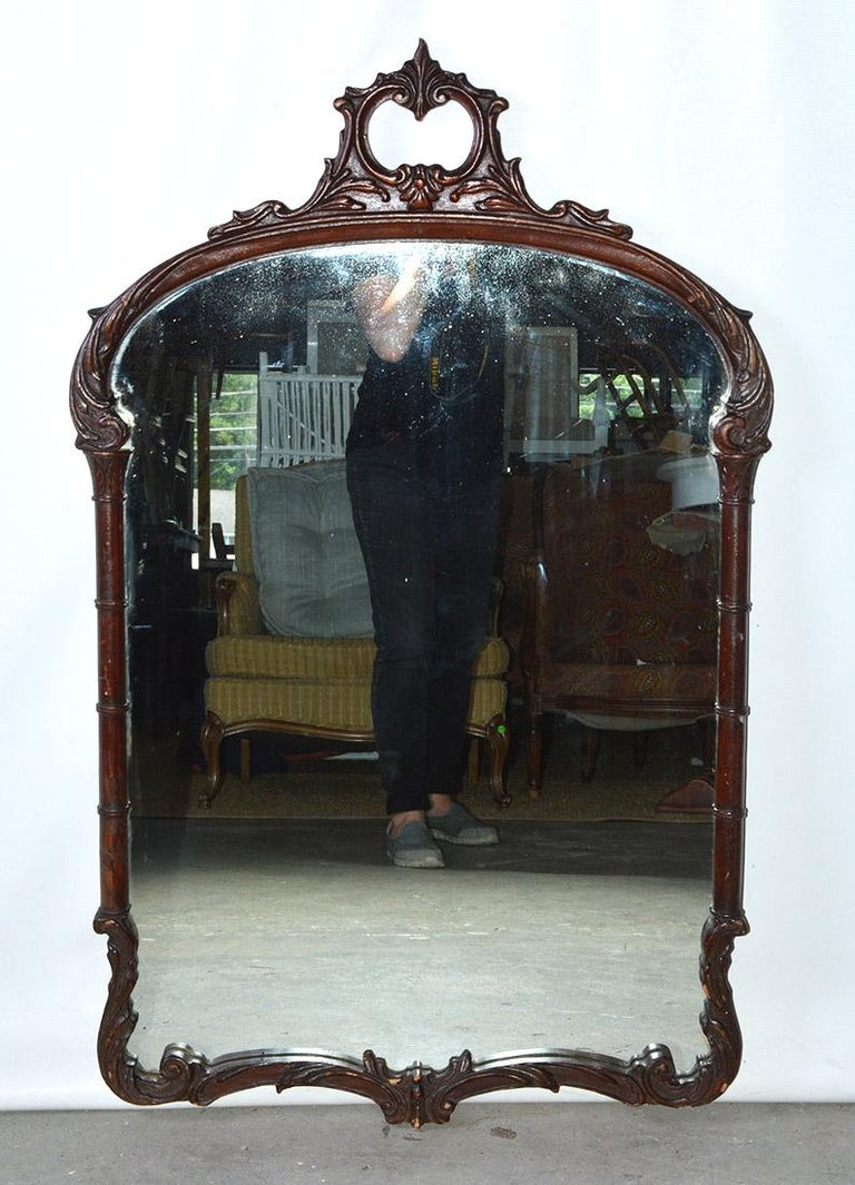 Old world elegance is the key to this antique Georgian mahogany hall mirror. Beautifully hand carved scroll work on the frame gives the mirror extra panache. Think beyond the hall: over a sideboard in the dining room, above a dressing table, above a