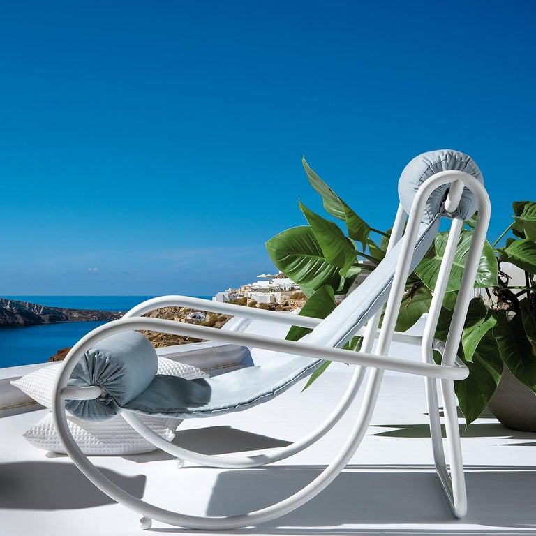 Recalling the classic shape of curved wooden rocking chairs, the voluptuous geometry of the steel tubular frame of this armchair convey a unique aesthetic that merges functional and stylistic elements. Designed by Italian architect Gae Aulenti in