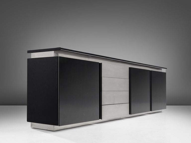 Lodovico Acerbis for Acerbis, sideboard, oak and steel, Italy, 1970s.  This elegant and modern credenza in stainless steel and stained oak is designed by Lodocivo Acerbis and part of the 'Parioli System'. Within this line of design Acerbis created