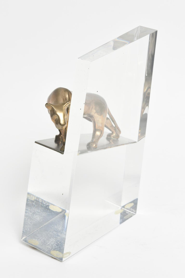 Striking bronze panther looking around the acrylic wall it is standing on. Designed by 20th century artist Vanderveen, Loet (Dutch, 1921-2015).  Marked on bottom of acrylic