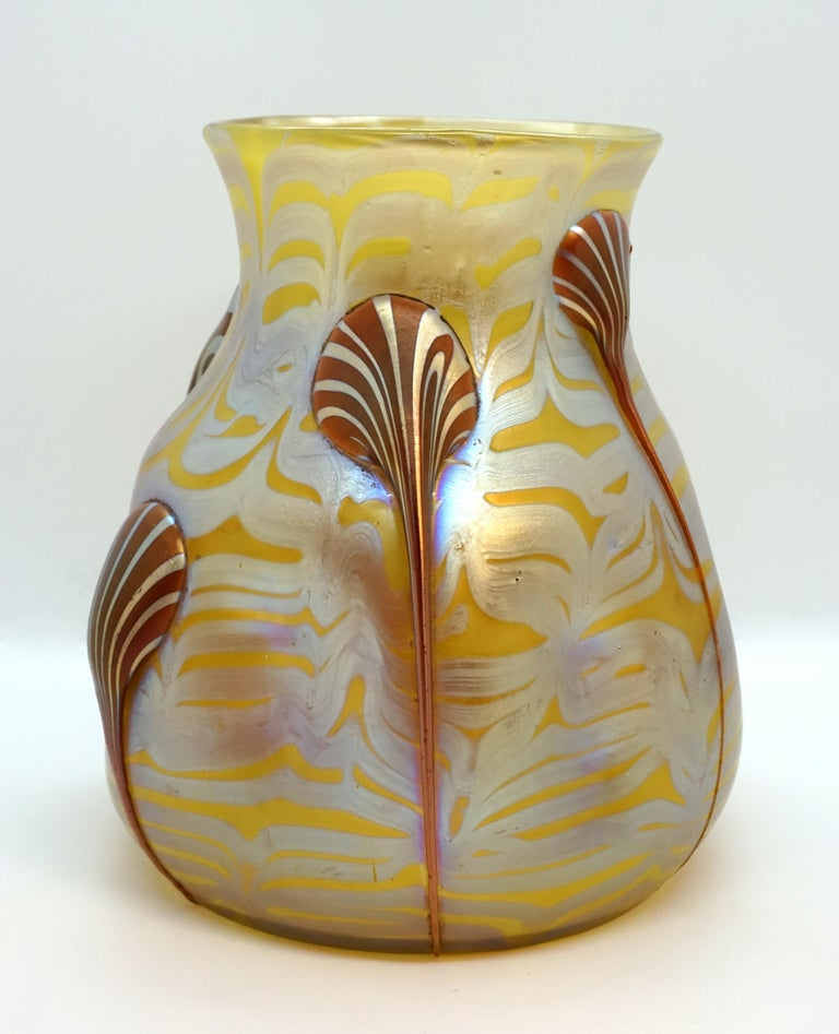 Finest Bohemian Art Nouveau glass vase  Blown, bulbous body with a raised mouth rim. Body pressed six times. Based on a round floor plan.  Shape: Series II Prod. Nr. 844, circa 1900  Decor: colorless glass covered with yellowish opal on the