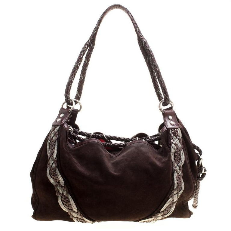 The lovely braided embellishments sitting atop the dark brown suede base makes this pretty hobo from Loewe a loved piece that must be added to your luxe closet. It has a relaxed structure featuring a spacious fabric-lined interior where you can
