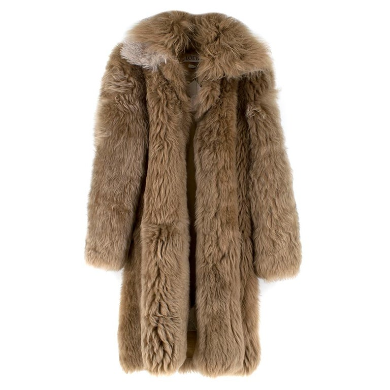 Loewe Toffee Lamb Shearling Double Collar Coat  -Shearling double collar coat -Calf skin interior rim -Cotton interior  -Three interior pocket -Large brown buttons for closure -Heavy weight  Please note, these items are pre-owned and may show some