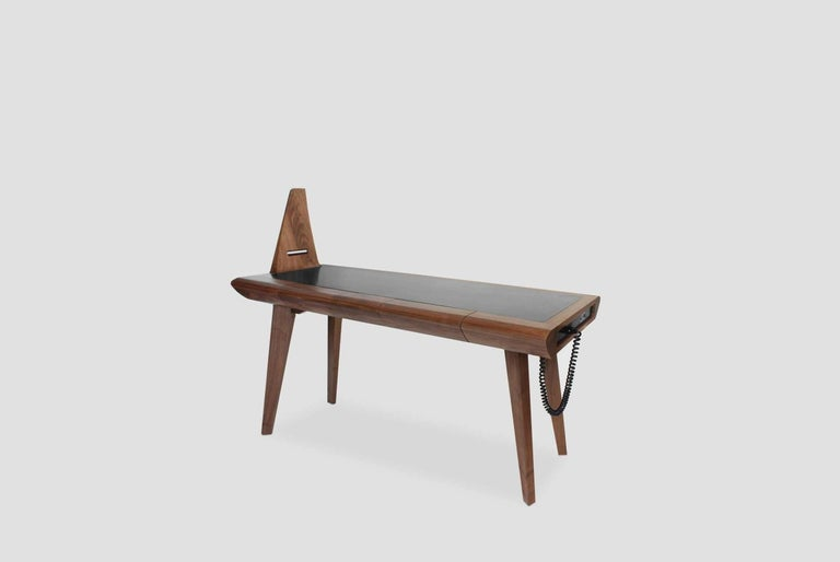 Loewy walnut work table was designed by Arturo Verastegui for BREUER ESTUDIO. This pice is part of Arquitectura y Ebanistería collection in which Arturo collaborated with BREUER to create exceptional pieces.  Arturo Verástegui is the director and
