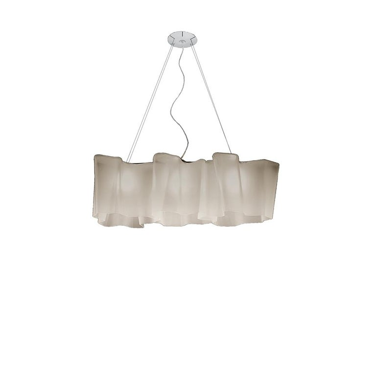 Inspired by the rays of light as they diffuse through the atmosphere, Logico's blown-glass diffuser takes an organic shape used throughout the collection.     Logico mini and classic are now available in three color options: milky white, smoky grey,