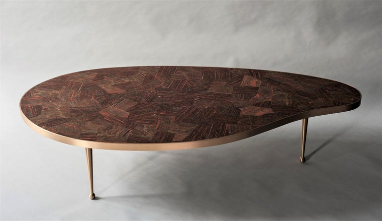 Lola coffee table by DeMuro Das  Dimensions: W 150 x D 71.5 x H 36.2 cm Materials: Unakite - Polished (Random)  Solid Bronze - Satin  Dimensions and finishes can be customized  DeMuro Das is an international design firm and the aesthetic and