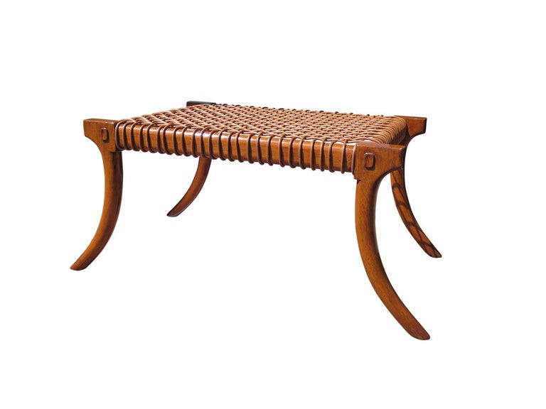 Klismos bench inspired by Robsjohn-Gibbings. Leather strapping. Can be made of alder, oak, walnut with different color of leather and stain. Can be made in custom sizes. Measures: 60