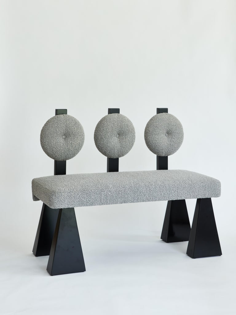 Made to order bouclé and wood settee designed by Christian Siriano.  Fabric for seat/back cushion: Gray Bouclé  Base: Black lacquered maple  Also available in natural maple and ivory bouclé.