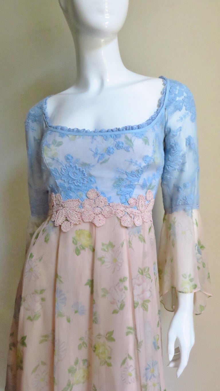 A beautiful ethereal dress from French designer Lolita Lempicka.  A great combination of blue lace and pastel peach silk with yellow and blue flowers.  It is fitted through the bust with a square neckline and pink lace dividing the top from the