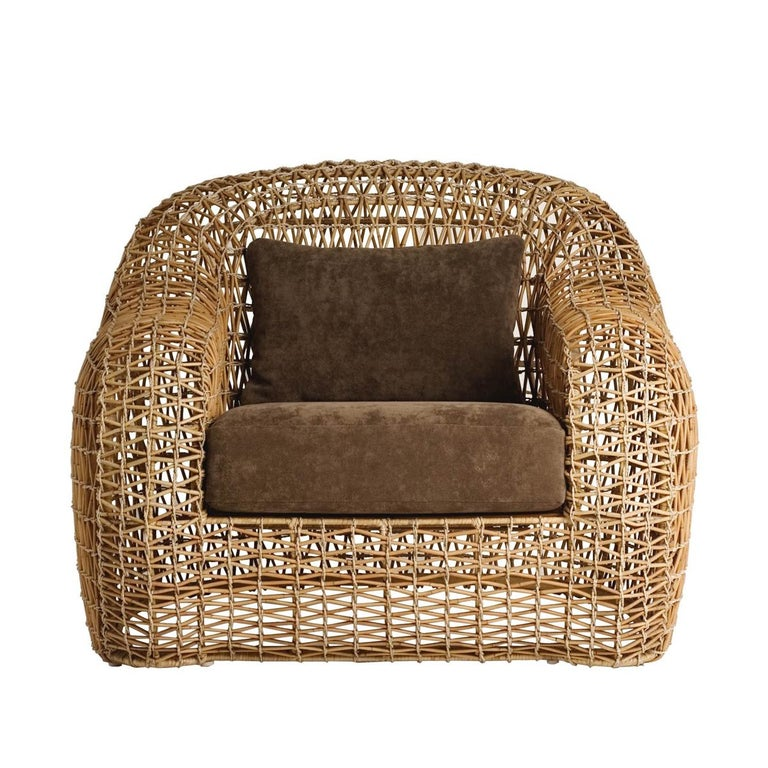 Armchair lombok Indoor or outdoor with structure in steel and natural rattan. With cushion seat and back included. Colors finish in taup, brown, or ocher. Lead time production if on stock 2-3 weeks, if not on stock 15-16 weeks.