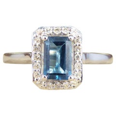 London Blue Topaz and Diamond Halo Cluster Ring in White Gold