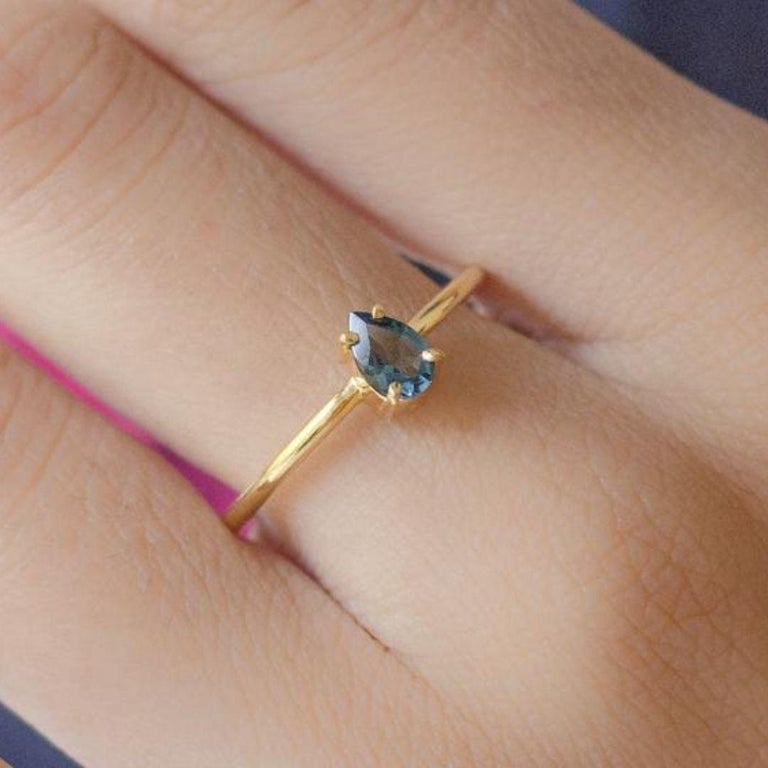 Handmade item Materials: Gold, Rose gold, White gold Gemstone: Topaz Gem color: Blue Band Color: Gold Style: Minimalist  London blue topaz teardrop shape gold ring. Perfect engagement ring with the blue gemstone. Pear-shaped single stone ring,