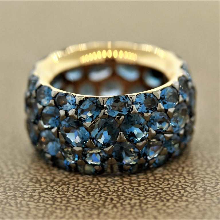 """A """"comfort fit"""" eternity band that fits smoothly and feels great being worn. It features 16.38 carats of London blue topaz with its famous deep blue color in oval shapes of different sizes. Made in 18k rose gold.  Ring Size 6.5"""