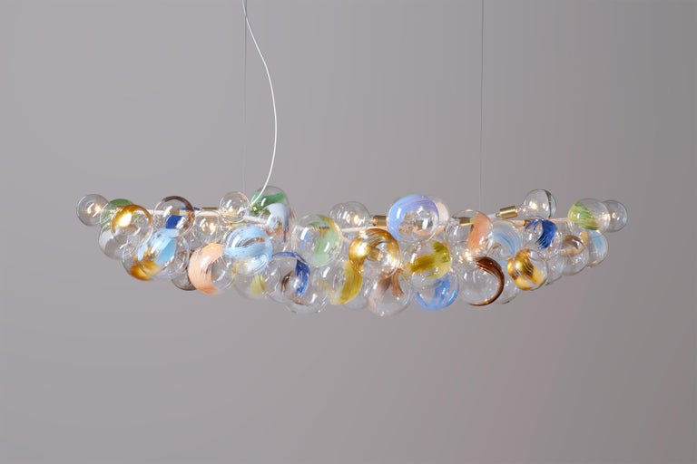 Ethereal and iconic, the Bubble chandelier is a modern re-interpretation of the crystal chandelier. Its luminous constellation of delicate glass globes adds beauty and depth to any interior environment.