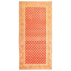 Long and Narrow Sunny Red Antique Khotan Carpet. Size: 7 ft 2 in x 14 ft 2 in