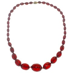 Long Art Deco Cherry Amber bakelite faceted bead necklace
