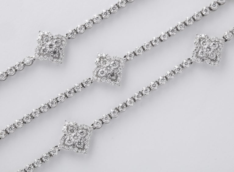 A FANTASTIC Diamond Necklace.  11.11 carats of white round brilliant cut diamonds set in 18k white gold.  30 inches in length -- the diamond motifs measure .40 x .40 inches approximately.   A beautiful gift!