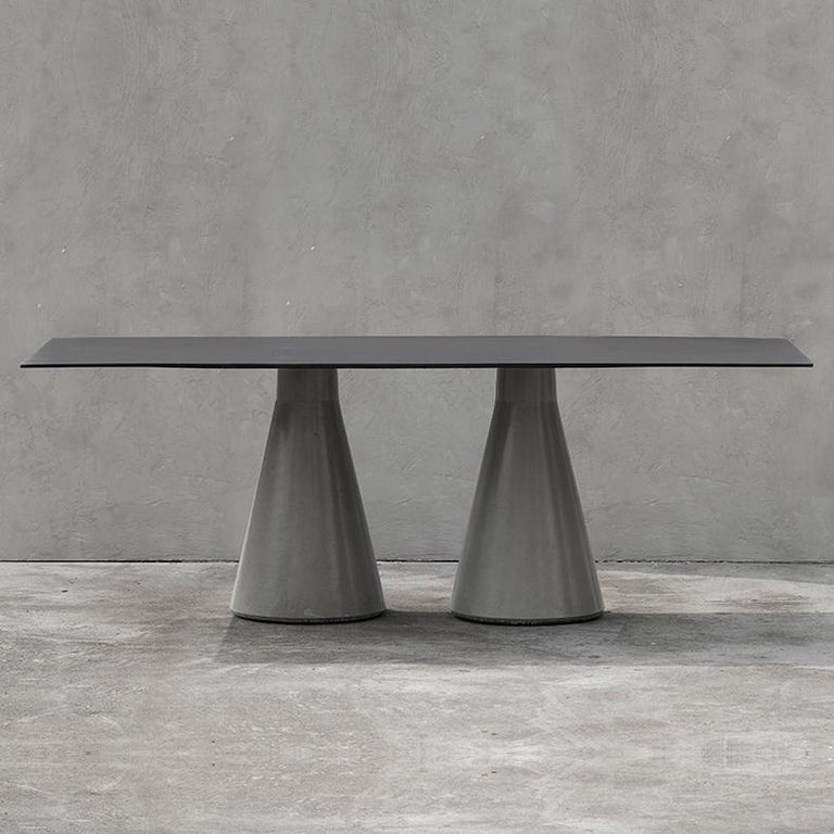 'DING' is a collection of tables: coffee / side tables, dining tables, bar tables.  The base is in concrete and the structure and to top in aluminum (black). by Bentu design  Tabletop and structure: Aluminum Table base: Concrete   Bentu