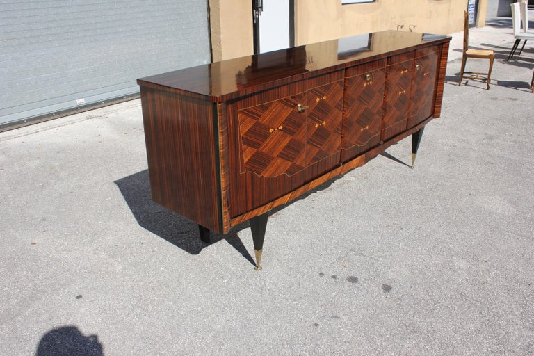 Long French 5 Doors Exotic Macassar Ebony Mother of pearl Sideboard / Buffet / Bar, circa 1940s. The sideboard are in very good condition, With 2 drawers inside, and with 4 shelves adjustable,you can remove all the shelves if you need more Space,