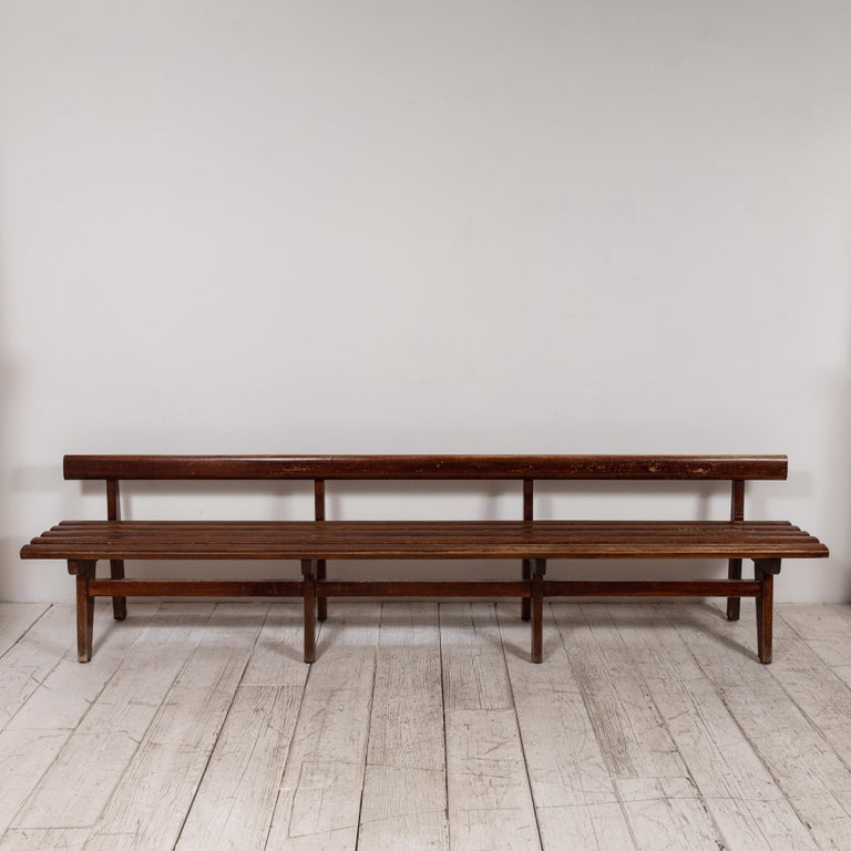 Long and low, this French slatted wooden bench is perfect for any hallway or room that has the space.