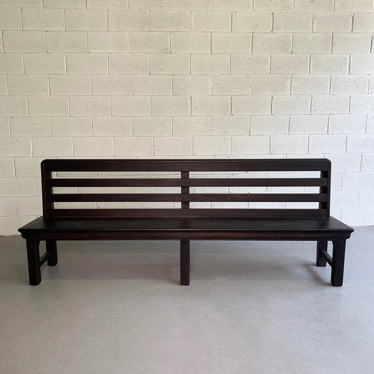 Industrial, 1940s, oak, train station bench features an ebonized finish and wonderful details all around. We have a second bench that can be finished to spec.