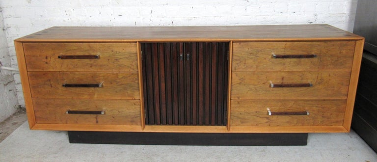 This long vintage modern dresser features six large spacious drawers, three smaller drawers. Wood inlay on the top, in two-tone rich wood grain.  Please confirm item location with dealer (NJ or NY).