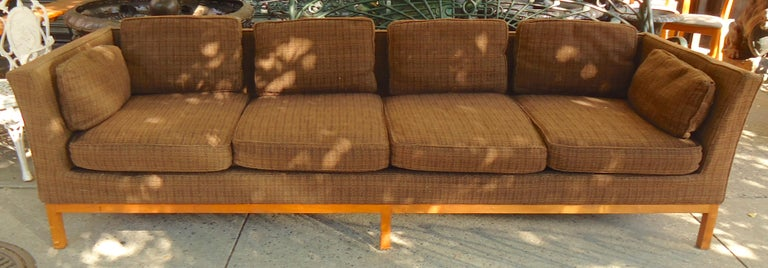 Four seat midcentury sofa with wood base. Simple and elegant design. (Please confirm item location - NY or NJ - with dealer).