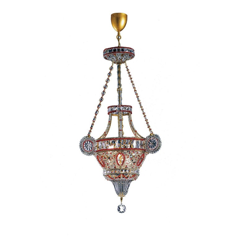 This magnificent chandelier is a superb piece of functional decor that will make a statement in a classically furnished home, thanks to its exquisite materials and a traditional-inspired silhouette. The hand-crafted structure is in forged iron and