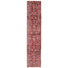 Long Runner Red Antique Sarouk with Floral Design in Excellent Condition