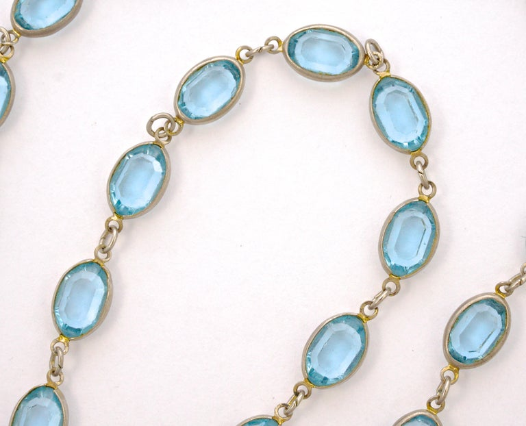 Long silver tone necklace with a spring bolt clasp, featuring lovely bezel set oval blue glass links. The glass stones are faceted and open back to catch the light. Measuring length 125cm / 49.21 inches and the glass jewels measure width 8mm / .31