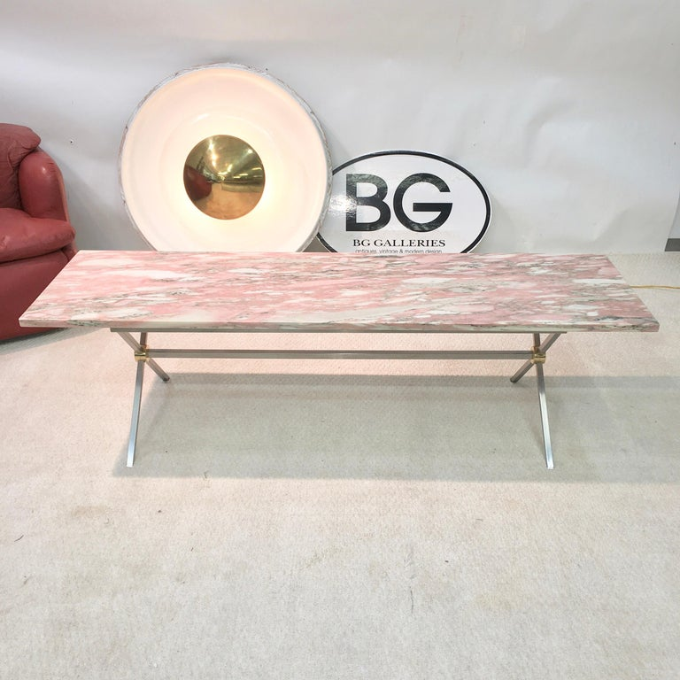 1950s X-base trestle table base constructed of square bar stainless steel and brass medallions supporting a rectangular slab of 3/4