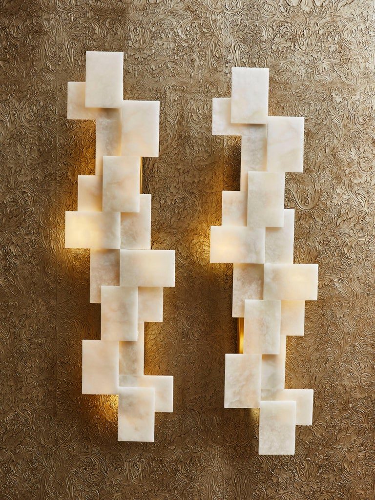 Stunning cubic wall sconces in enlightened alabaster and brass structure. Different stone, finishes and dimensions can be ordered. Creation by Studio Glustin. France, 2020.