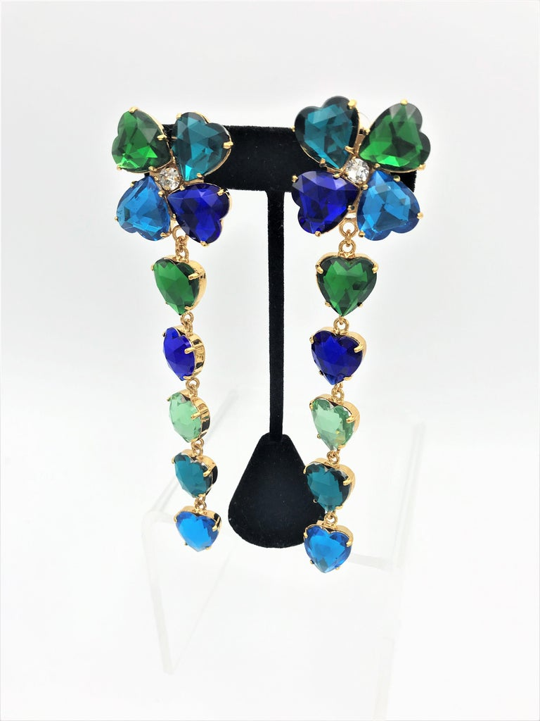 Gorgeous YSL ear clips made from 5 different colored cut rhinestone hearts.  4 hearts in different colors make a shamrock at the top. The remaining 5 hearts hang loosely on the clover leaf and move playfully. This is such a beautiful YSL ear