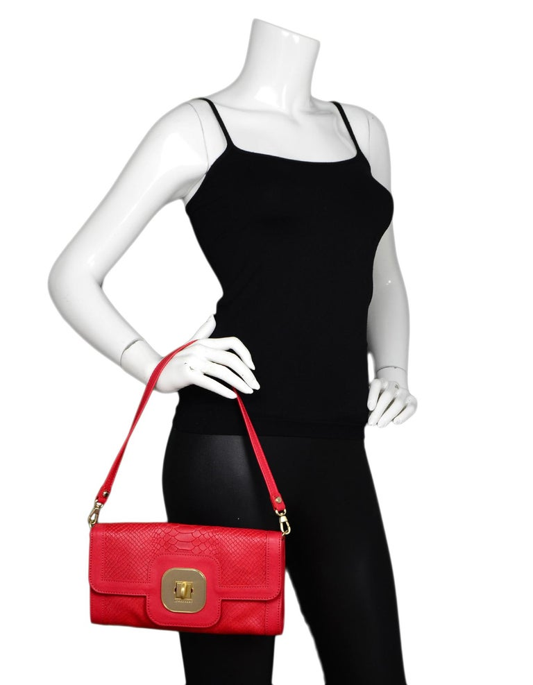 Longchamp Red Leather Embossed Snake Gatsby Flap Clutch/Shoulder Bag  Made In: France Color: Red Hardware: Goldtone Materials: Embossed leather Lining: Leopard satin textile Closure/Opening: Flap top with twistlock Exterior Pockets: None Interior