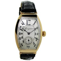 Longines 14 Karat Gold Art Deco Tonneau Shaped Manual Watch, circa 1920s