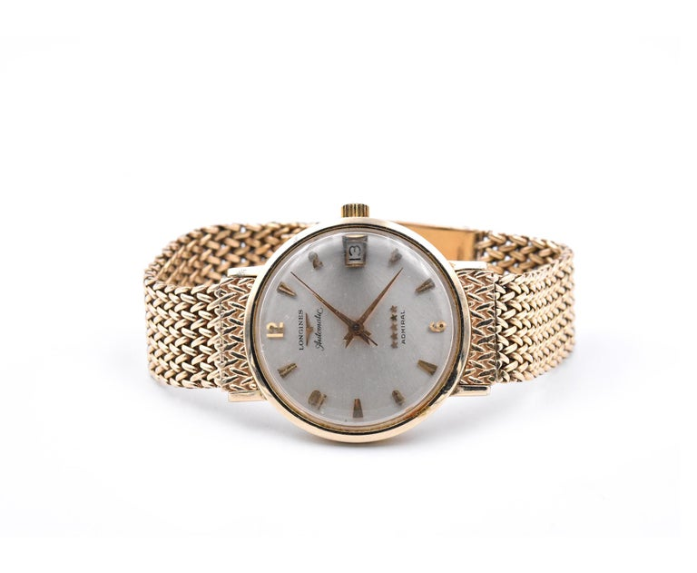 Movement: automatic Function: hours, minutes, seconds, date Case: 34.60mm case, smooth bezel, plastic crystal Dial: silver dial with gold hour markers, gold hands Band: 14k yellow gold bracelet with a double fold-over clasp, will fit up to a 7