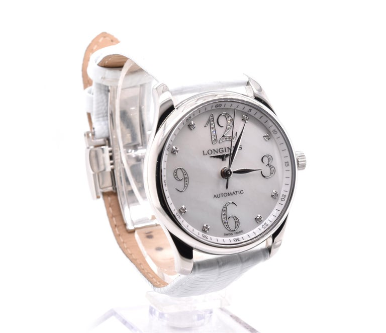 Brand: Longines Movement: automatic Function: hours, minutes, seconds Case: 36mm case, smooth bezel, sapphire crystal Dial: mother-of-pearl diamond dial Band: generic white lizard strap with factory Longines buckle, will fit up to a 7-inch