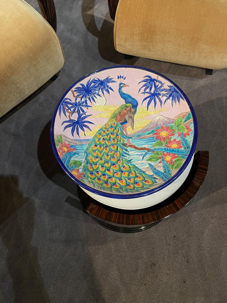 A rare large decorative French deep wall charger by R. Rizzi for Faiences de Longwy de Luneville. Decorated in a crackle glaze of vibrant colors and gilt and enameled with a peacock surrounded by colorful foliage. Craquelle white ground and metallic