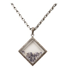 Loose Stones of Diamonds and Iolite in Picture Frame Pendant on Long Chain