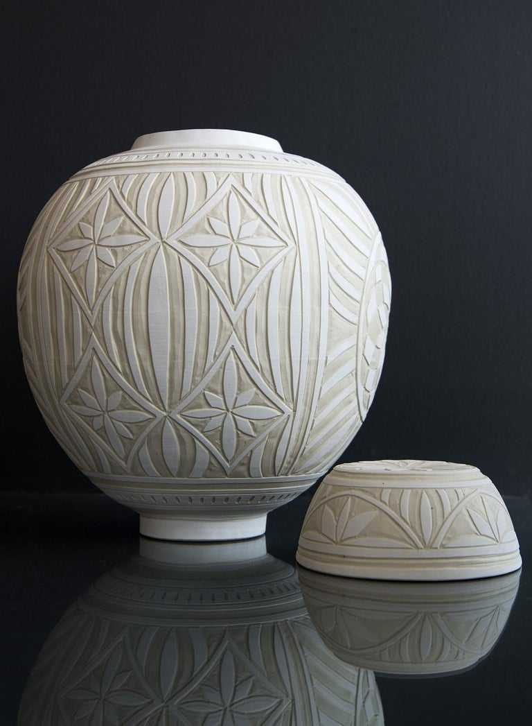 This beautifully detailed medium-sized porcelain vessel was created by ceramicist Loren Kaplan.   'Ginger jars' were first used in China thousands of years ago as a means of storing and shipping precious spices. Ginger became a popular spice in the