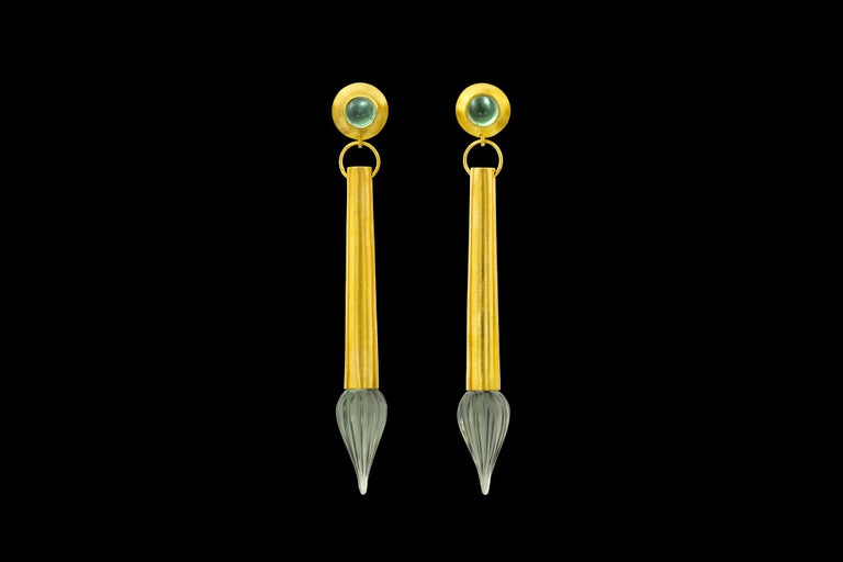The torpedo earring is part of Loren Nicole's permanent collection.  This one of a kind variation features a carved Prasiolite
