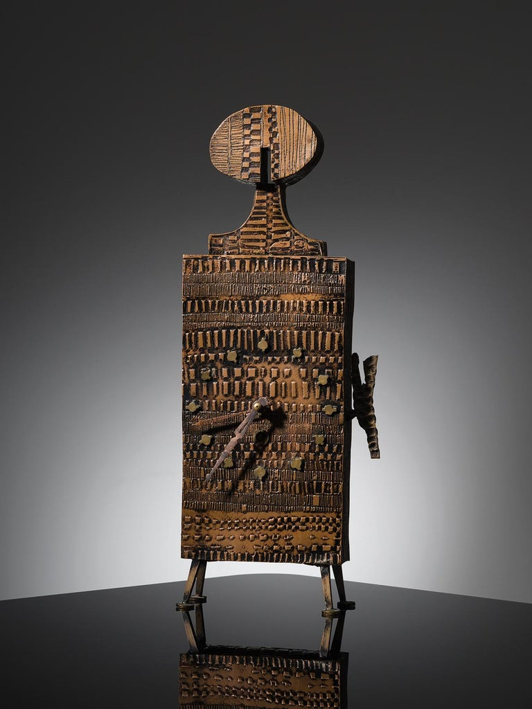 Lorenzo Burchiellaro, table clock, copper, brass, Italy, circa 1965  This figurative table clock is designed by Lorenzo Burchiellaro. It is executed with a copper body and has brass details such as the legs and dial. This specific piece is an