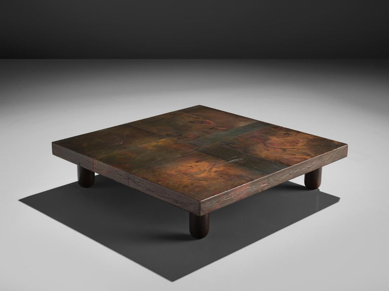 Lorenzo Burchiellaro, handcrafted coffee table, copper, wood, Italy, 1960s  Lorenzo Burchiellaro is known for his artistic use in metals and the creation of decorative objects and furniture. This side table is no exception. With the square top that
