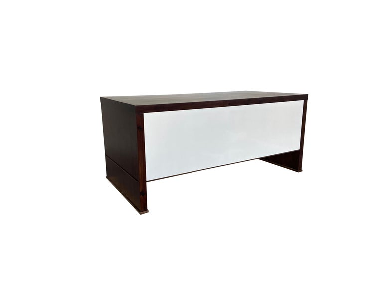 This classic yet modern desk features an Argentine rosewood body and white mirror-polished lacquered face and drawers with bronze accents. The drawers feature soft-close hardware and can be used with the pulls of your choice, or as shown, with none.