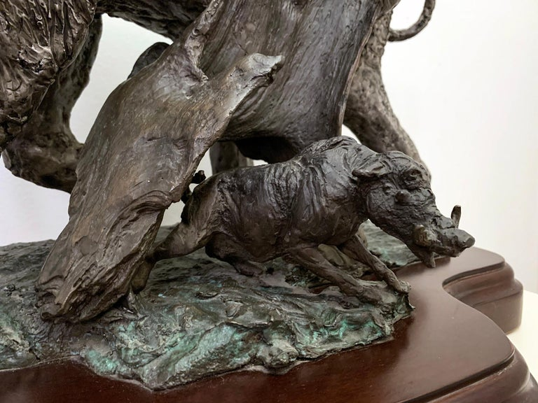 A stunning large bronze sculpture depicting a majestic elephant with a warthog. Signed in bronze, circa 2003, 5/250. Acquired directly from artist.  Lorenzo Ghiglieri is an Oregon artist and sculptor (b. 1931). The Portland, Oregon newspaper