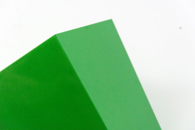 This playful, structurally precise wall sculpture by American artist Lori Cozen-Geller is smooth surfaced and coated in glossy spring green. This work is available as a commission in white or any color of your choice.  Each version is unique.